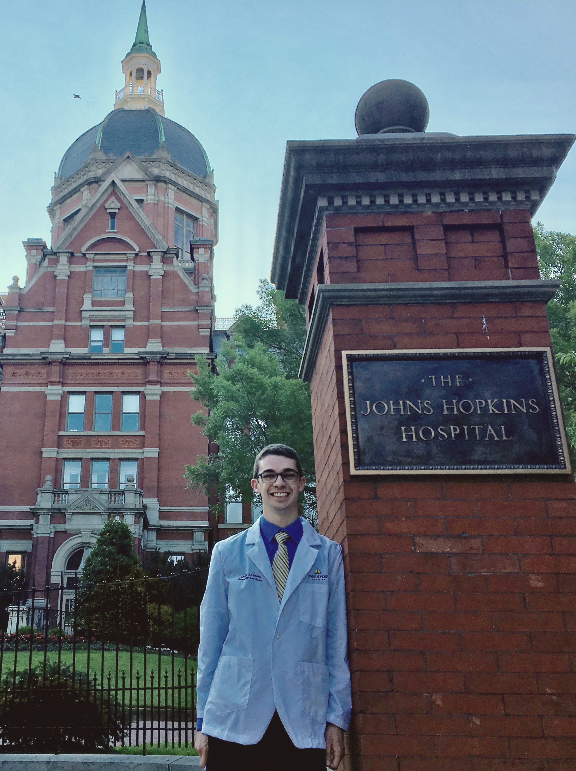 Andrew Smith poses in front of the Billings Hospital Administration Building