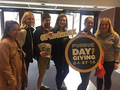 Photo of students promoting Day of Giving