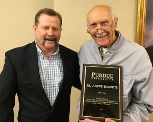 Dr. Watts presents plaque to Dr. Borowitz at retirement celebration