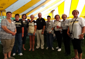 Photo of alumni at the annual Homecoming Chili Supper
