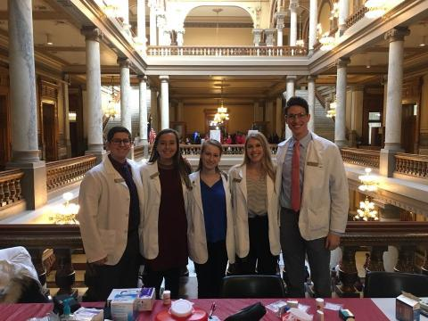 Pharmacy students in the State House rotunda